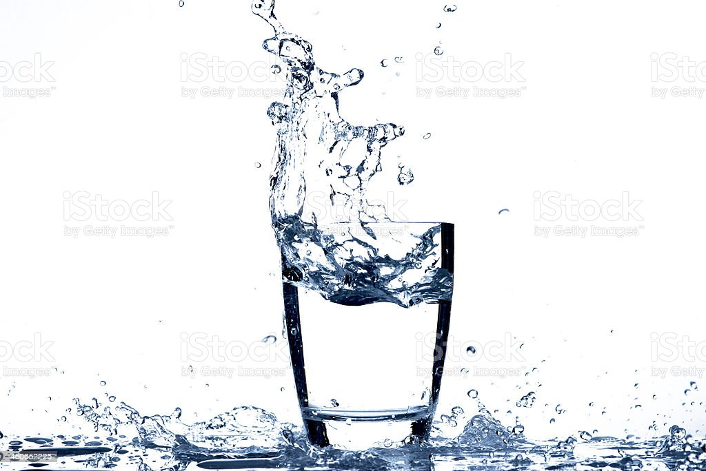 Water pouring to glass stock photo