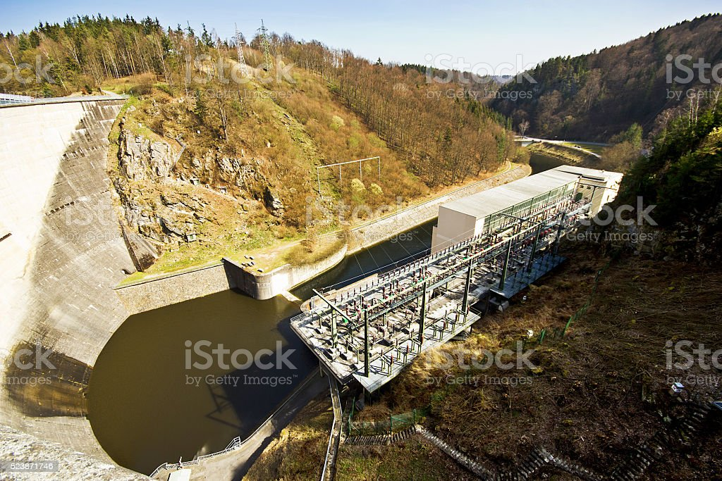 Water power plant. The concrete dam on the river. stock photo