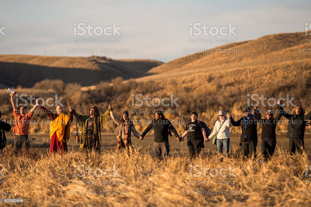 Water Protectors hold hands in solidarity at Standing Rock stock photo