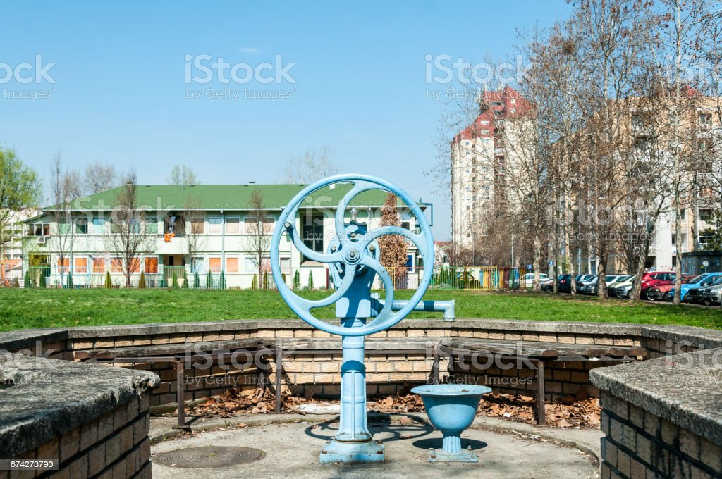 Water pump. Old hand water pump in the city. stock photo