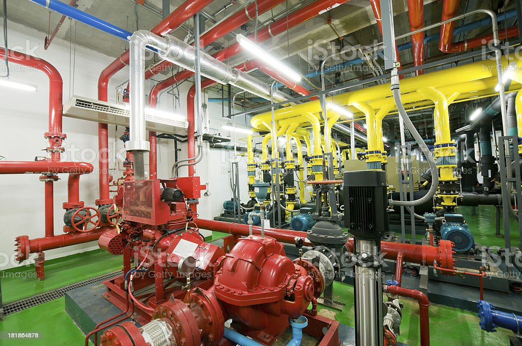Water pumping station and industrial interior pipes stock photo