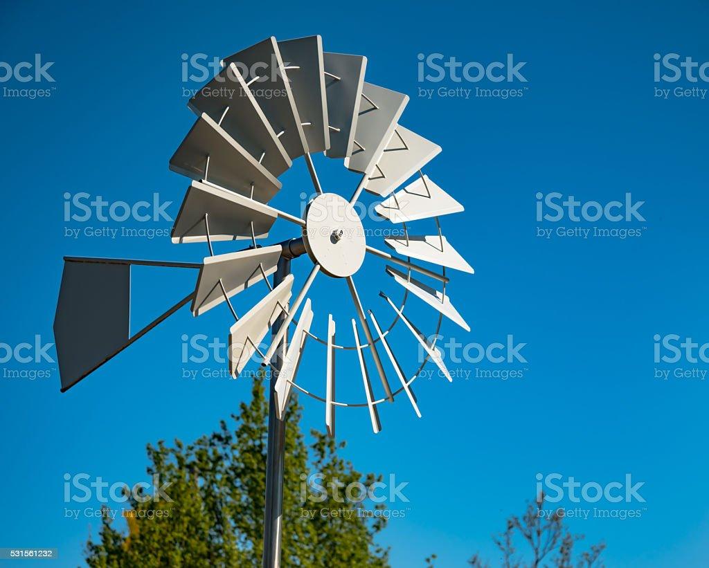 water pumping windmill stock photo