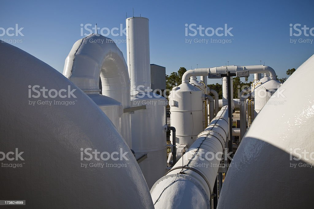 Water Purification Plant Late Day Long Shadows Numerous Transfer Pipes stock photo