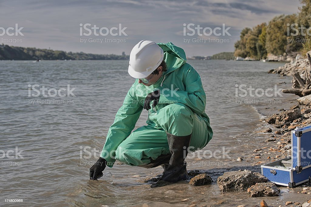 Water quality inspector filling up sample container stock photo