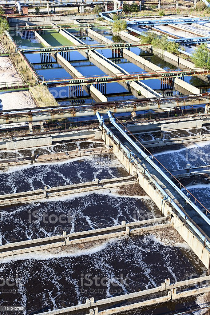 Water recycling, settling, purification in tank on sewage treatment plant stock photo
