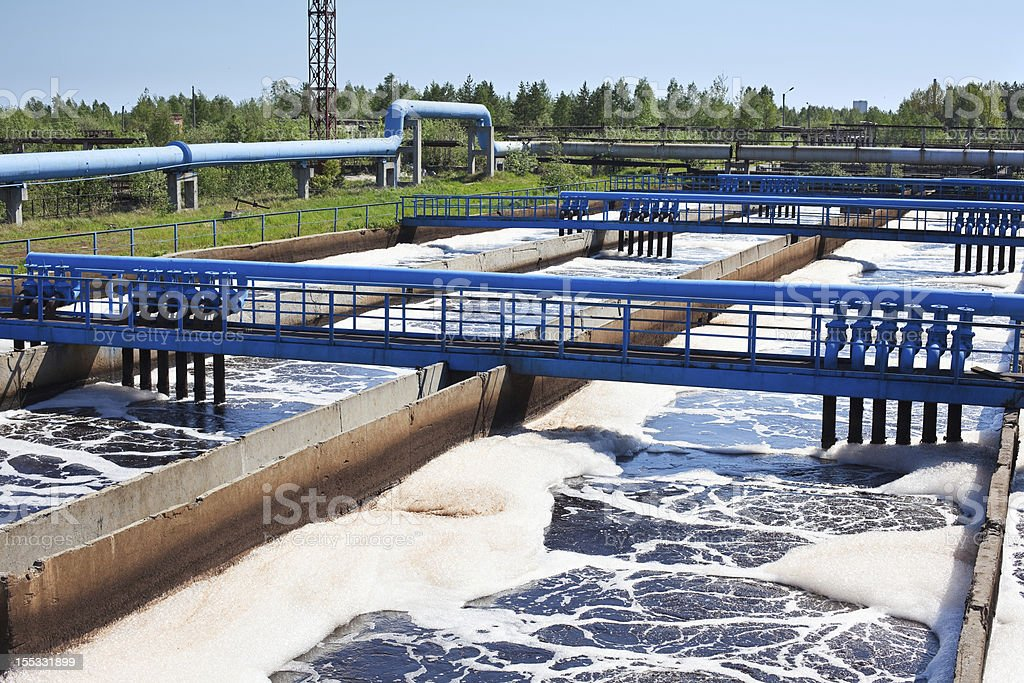 Water recycling through sedimentation drains stock photo