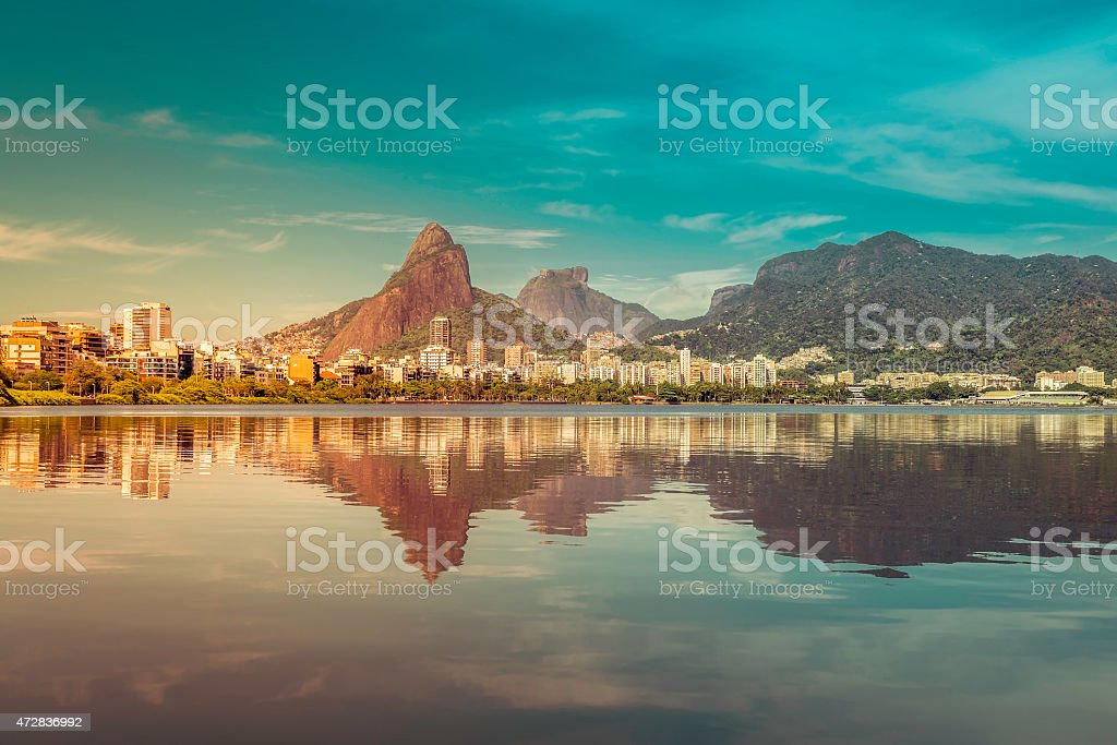 Water reflecting the sunrise at Sugarloaf Mount in Rio stock photo