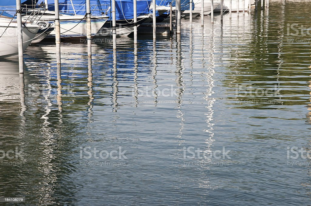 water reflections from sailboats in marina royalty-free stock photo