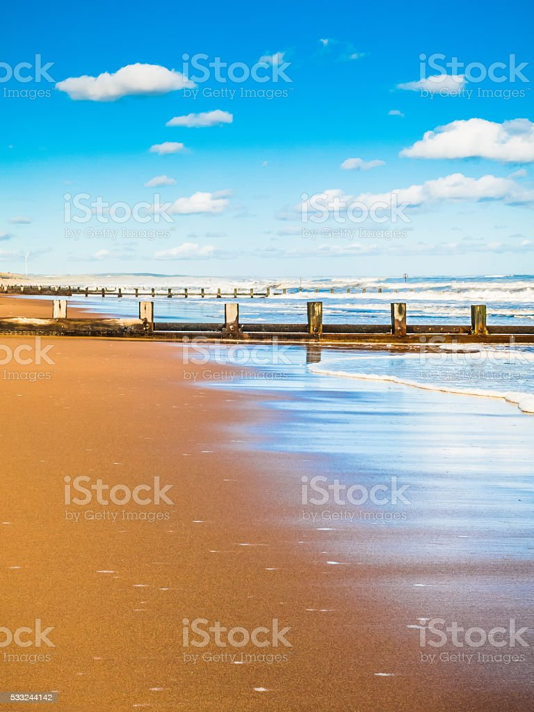 Water Reflections on Beach, Aberdeen, UK. stock photo
