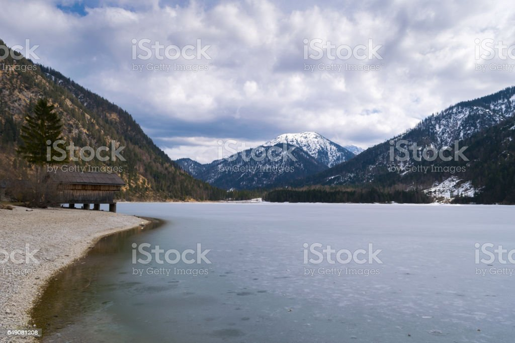 Water reflexions in cold spring, Plansee Lake, Tyrol, Austria, Europe stock photo