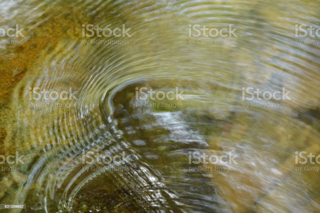 water rippled and spreading stock photo