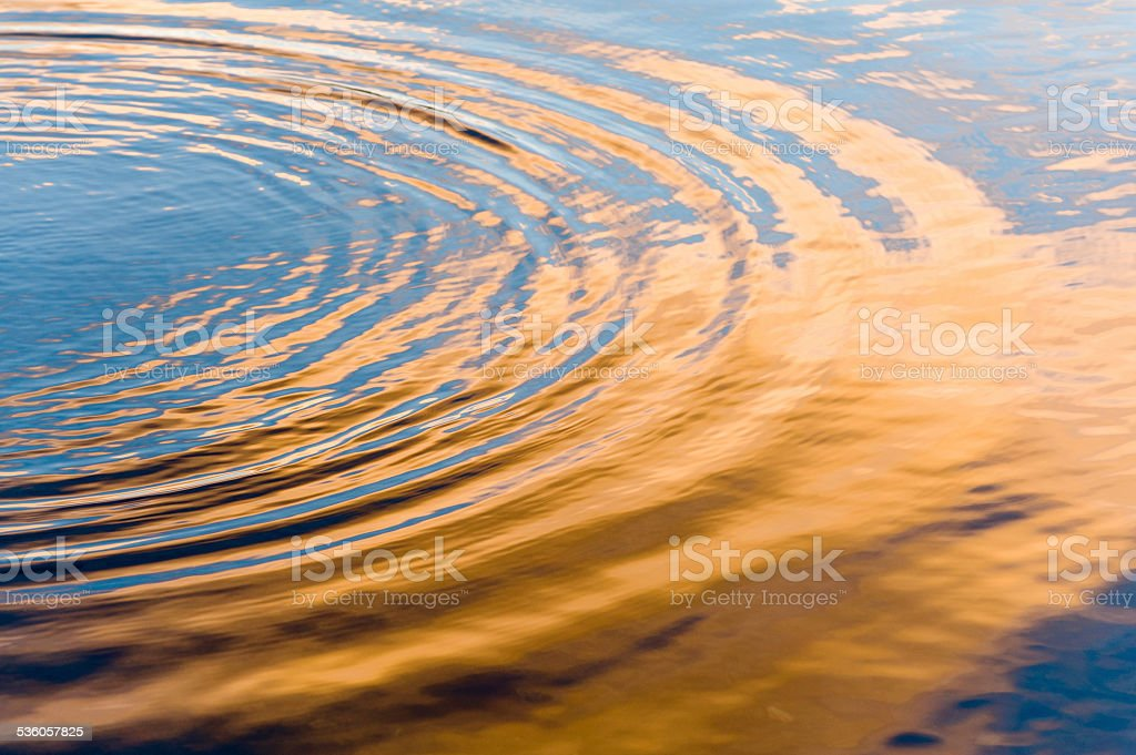Water ripples at sunset stock photo