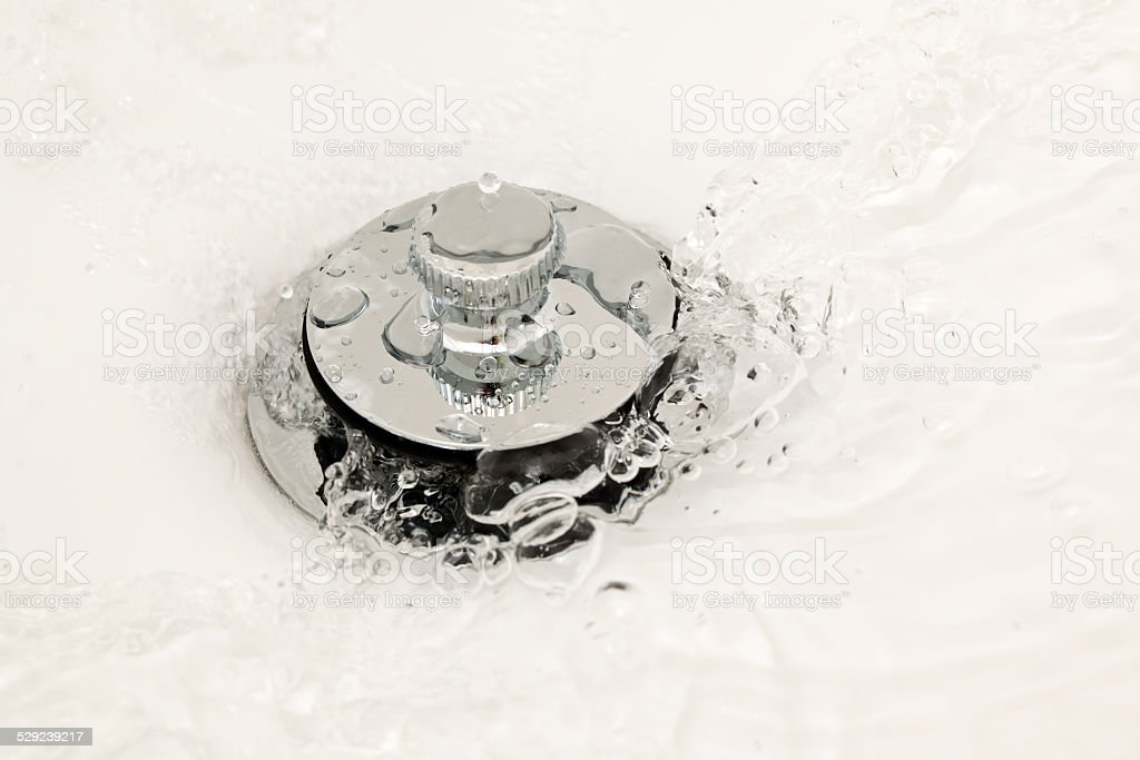 Water Running Down the Drain stock photo