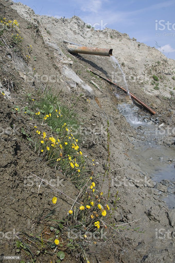 Water running form the pipline stock photo