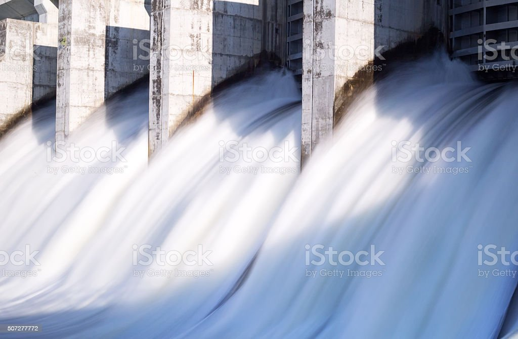 Water rushing out of hydro dam stock photo