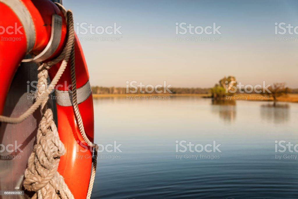 Water safety bouy on boat in Yellow Water billabong at dawn, Northern Territories, Australia stock photo