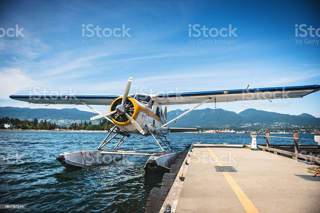 Water seaplane at the dock ready to leave stock photo