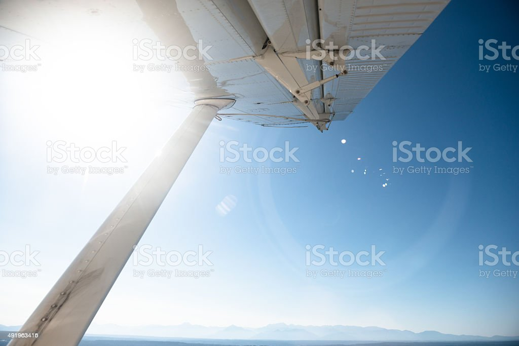 Water seaplane flying over the seattle stock photo