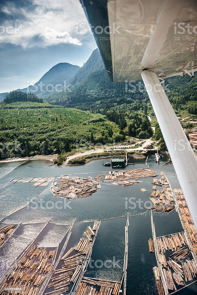Water seaplane flying over the vancouver landscape stock photo