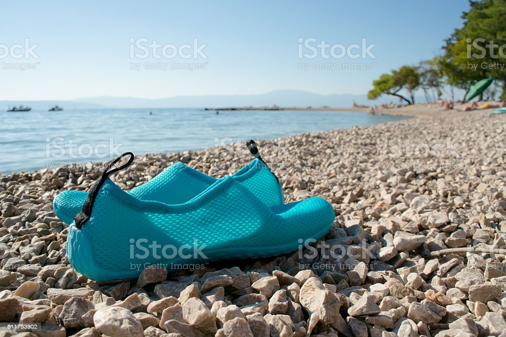 water shoes on the beach stock photo