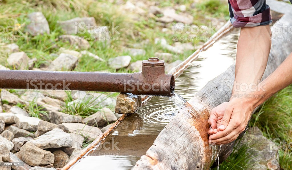 water slows form pipe stock photo