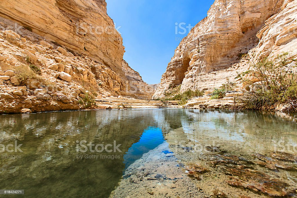 water source in the rocky valley stock photo