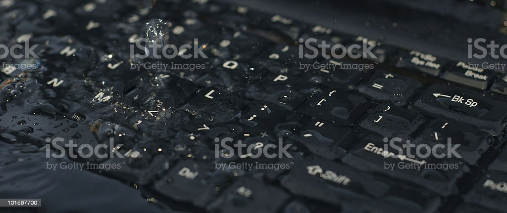 water spilled on computer keyboard royalty-free stock photo