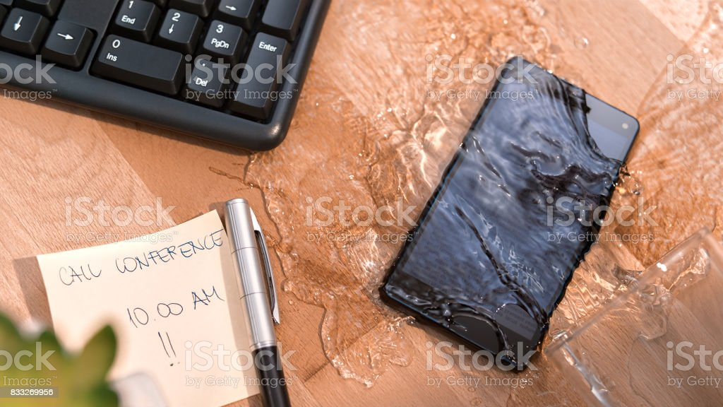 Water spilling on smart phone stock photo