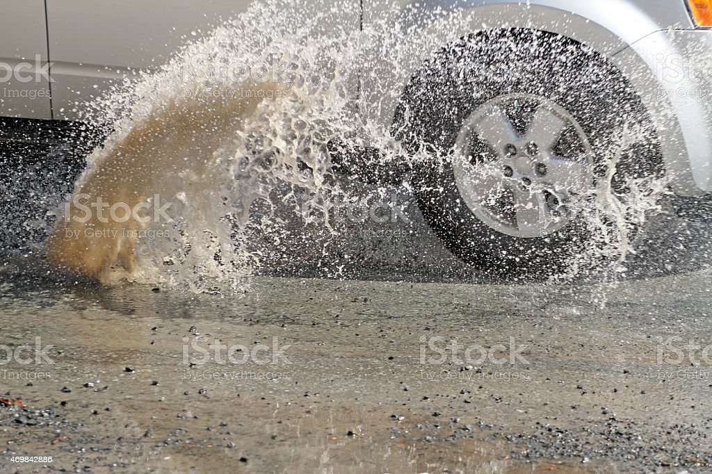 Water Splash Created By A Car Hitting A Pothole stock photo