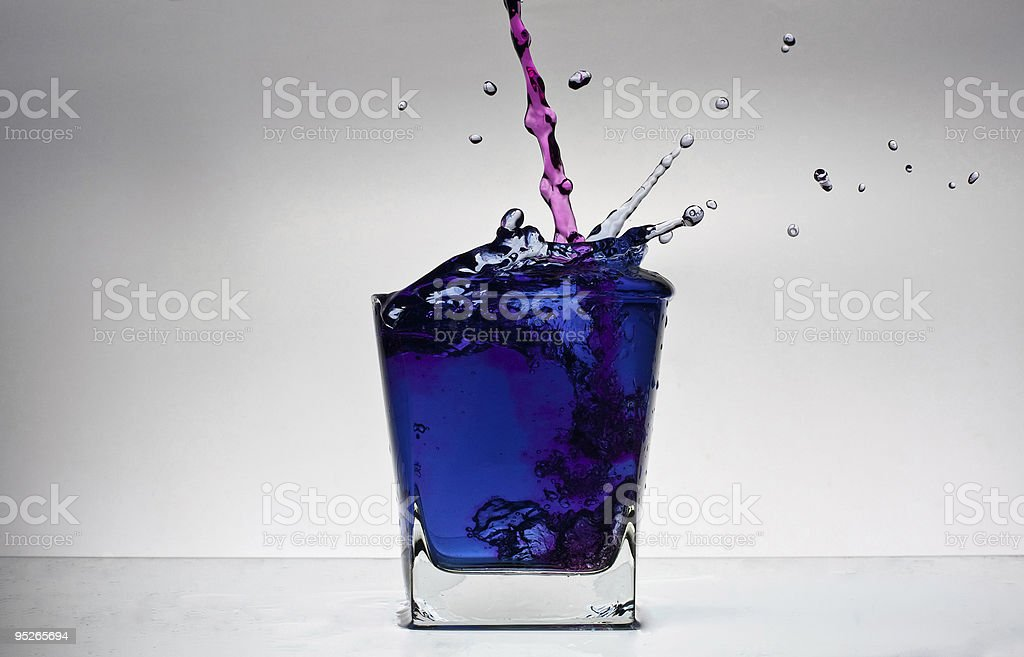 Water splash in a glass royalty-free stock photo