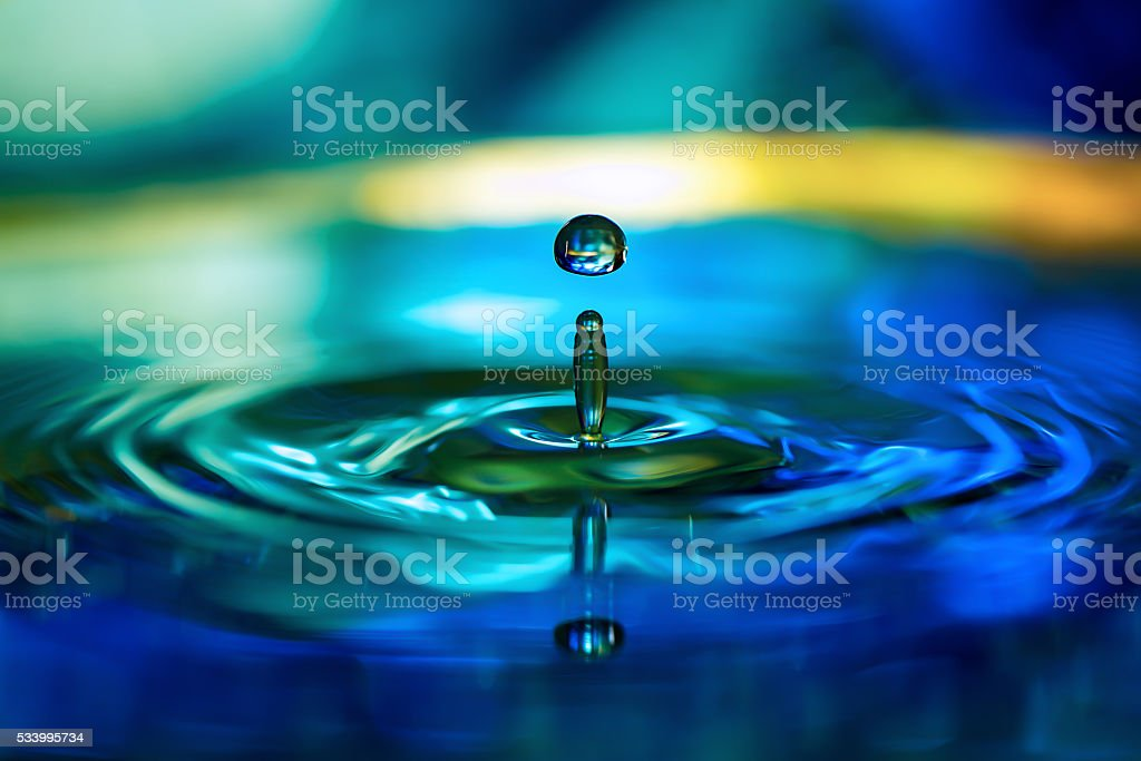 Water splash in blue background stock photo