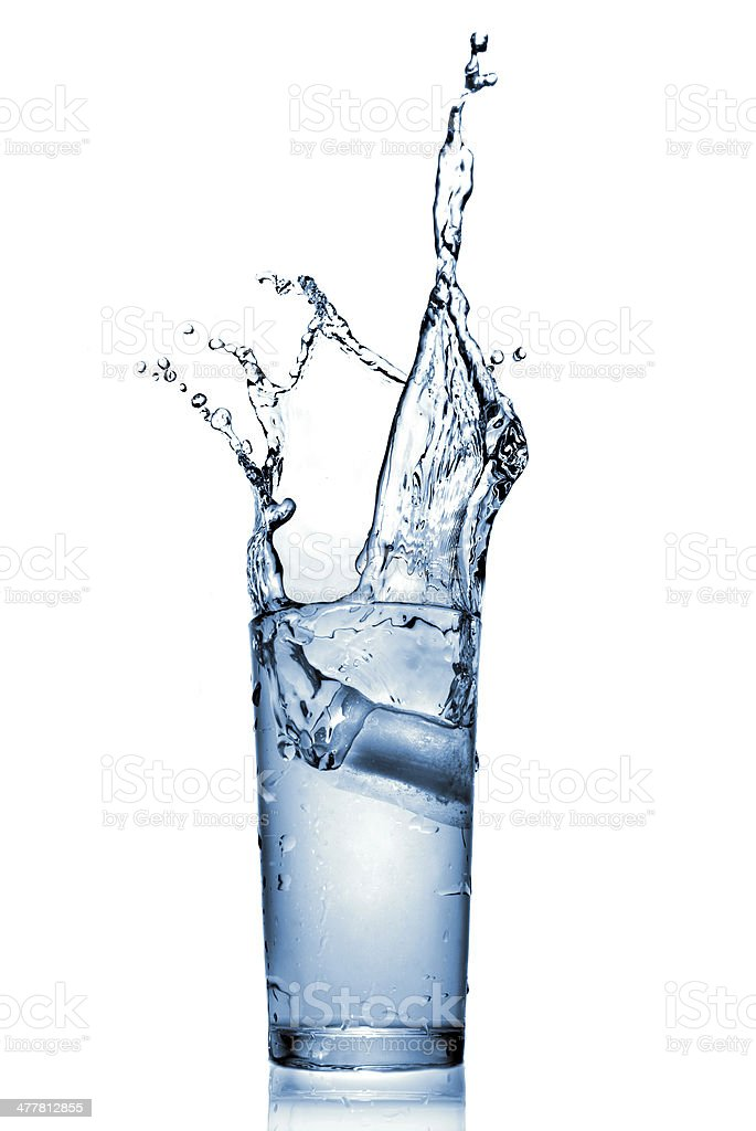 water splash in glass isolated on white royalty-free stock photo