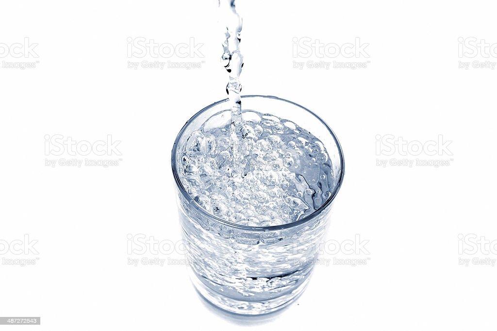 Water splash in glass. stock photo