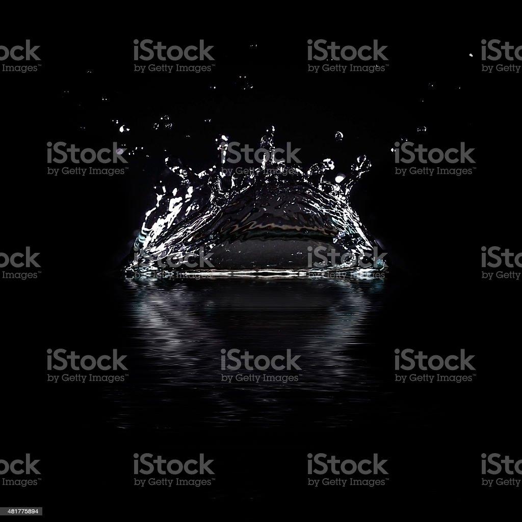 Water splash isolated on black background. stock photo