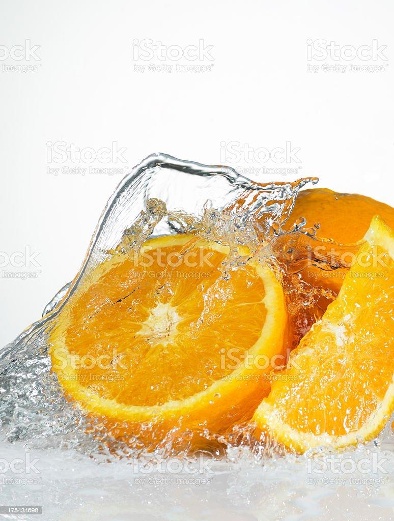 Water Splash on Fresh Oranges. Close-Up. stock photo