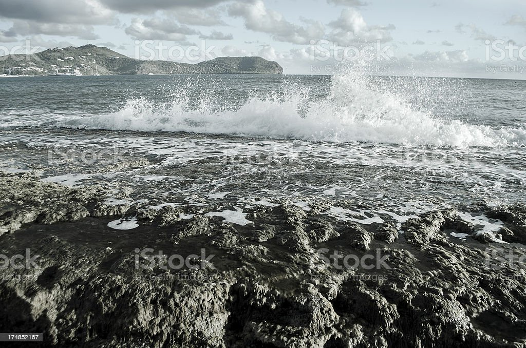 water splash on rocky artificial reef royalty-free stock photo