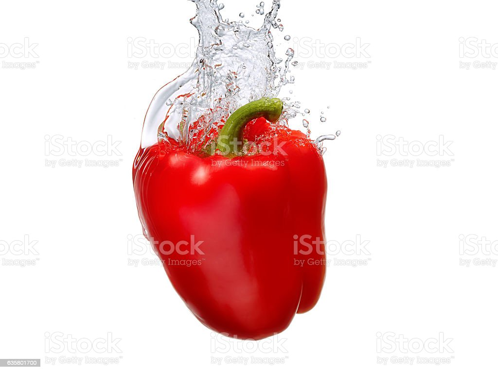 Water splash with bell pepper isolated stock photo