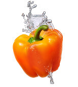 Water splash with bell pepper isolated