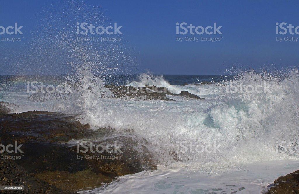 Water splash with rainbow stock photo