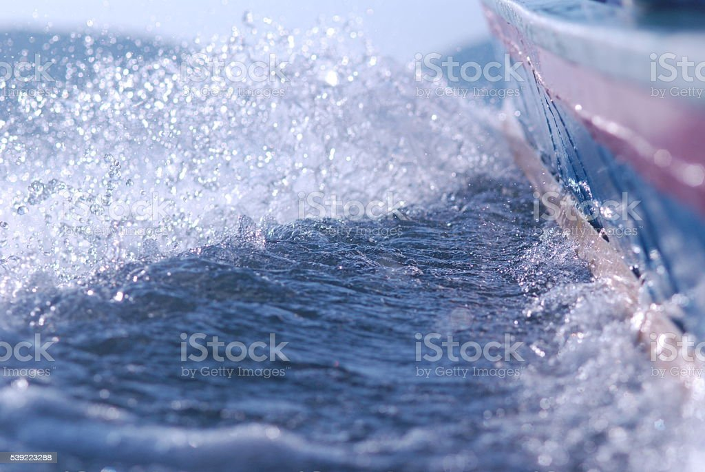 Water splashes from boat stock photo