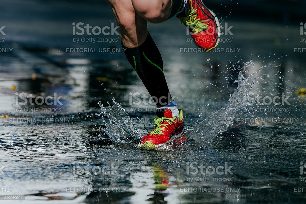 water splashes from under its running shoes royalty-free 스톡 사진