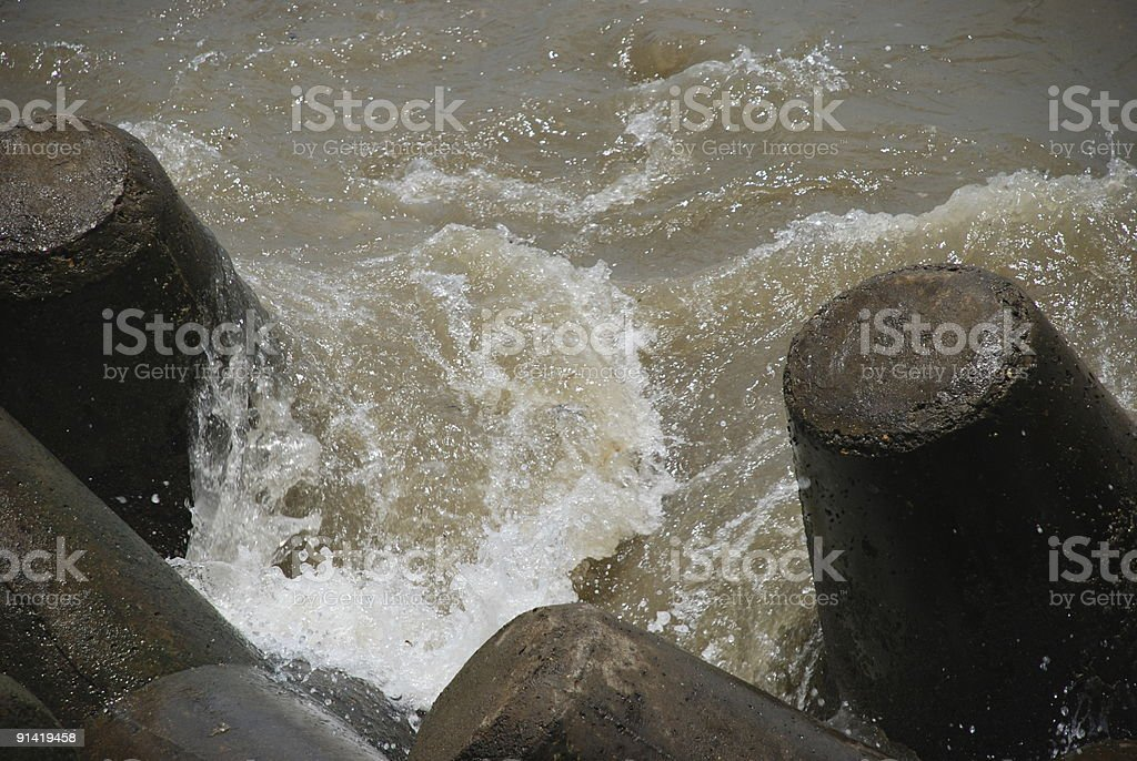 Water splashing against rocks, Mumbai, India 1 stock photo