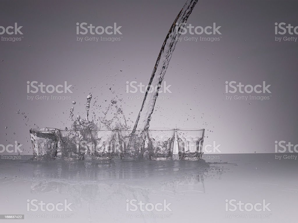 Water splashing from glasses royalty-free stock photo