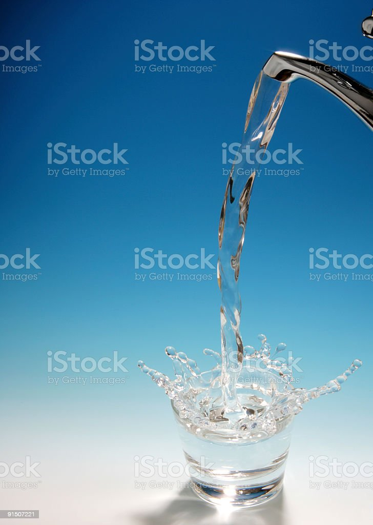 Water Splashing Into a Glass royalty-free stock photo