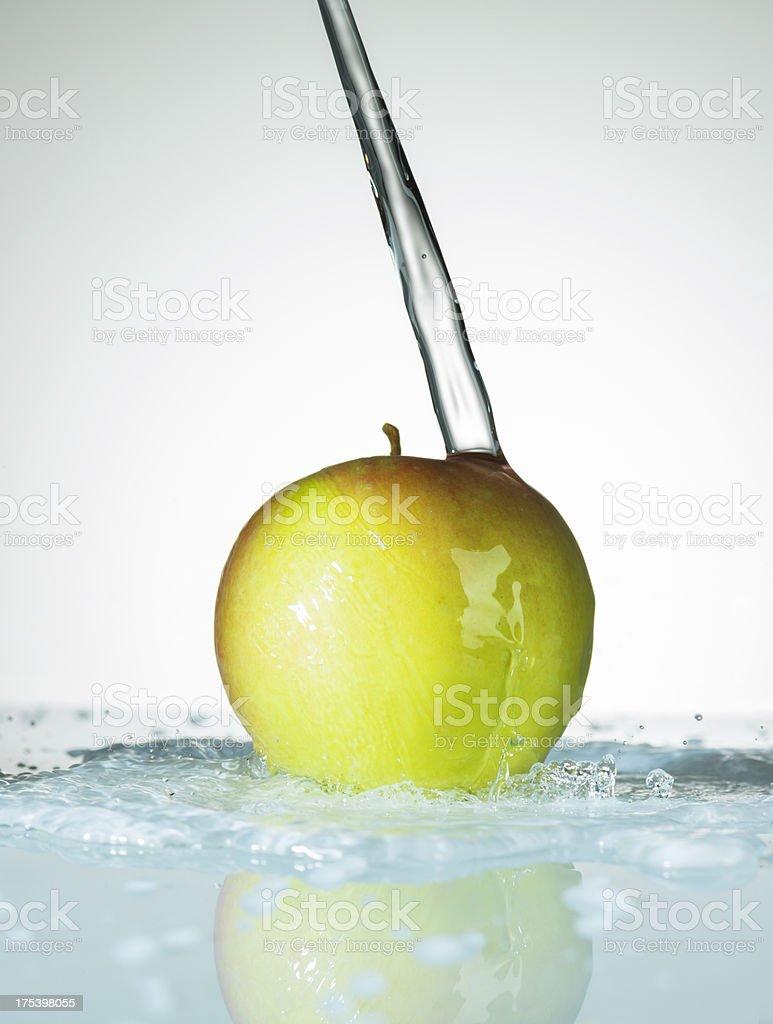 Water Splashing on a Fresh Apple stock photo
