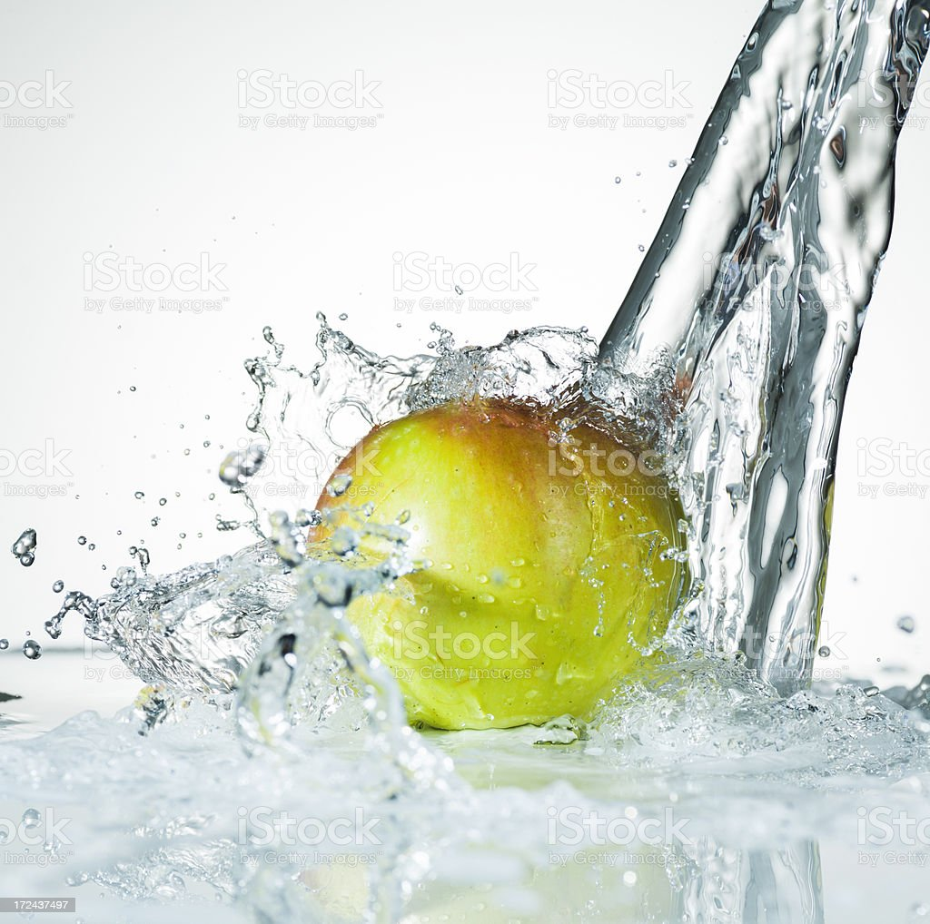 Water Splashing on a Fresh Green Apple royalty-free stock photo