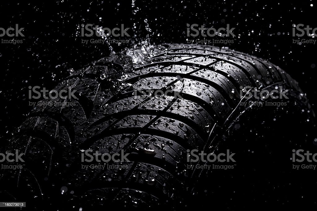Water splashing on a new tire during the rain royalty-free stock photo