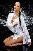 water splashing on sensual model