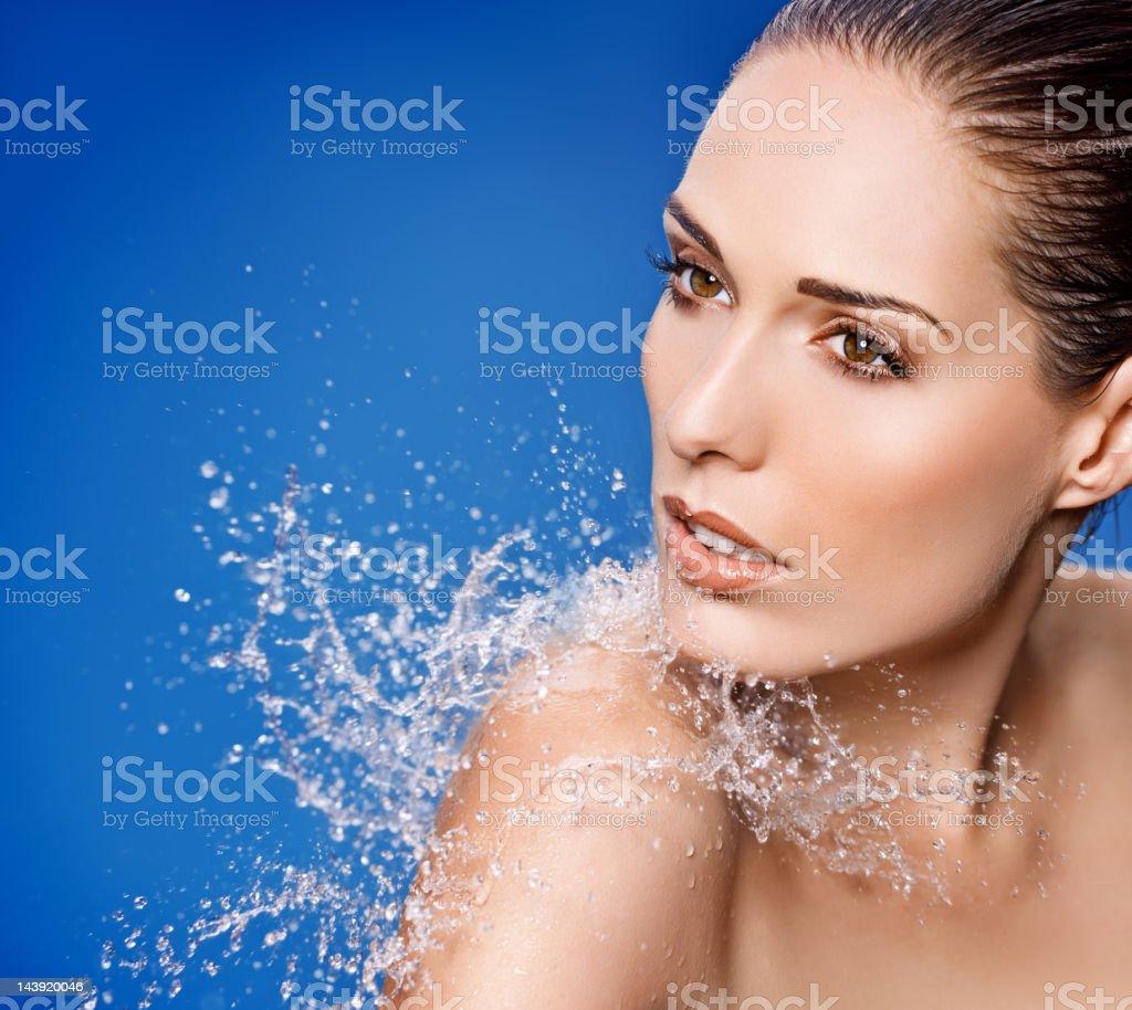 water splashing on sensual model royalty-free stock photo