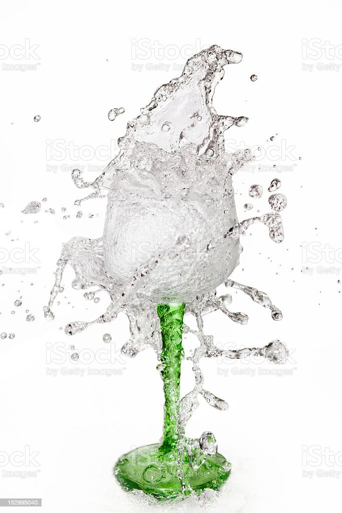 Water splashing out of a glass stock photo
